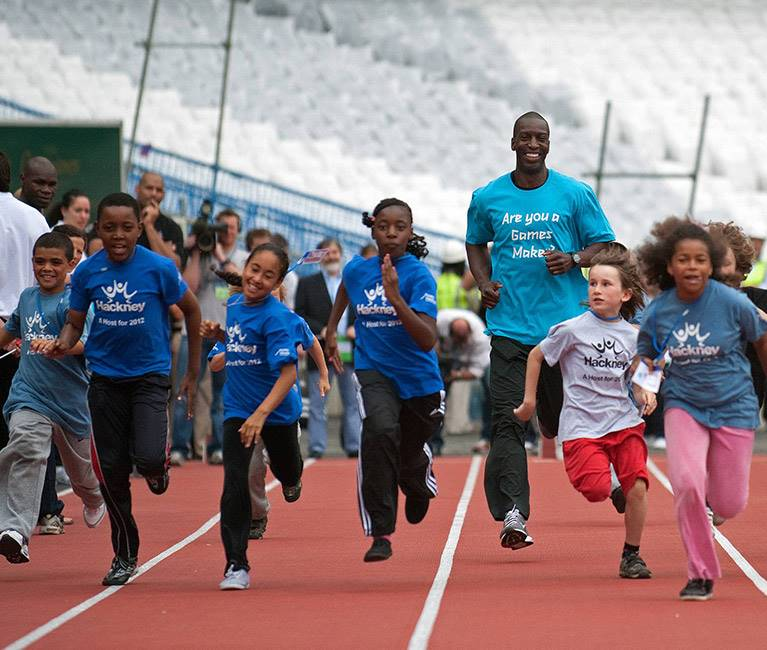 Children running on race track at Olympic Stadium
